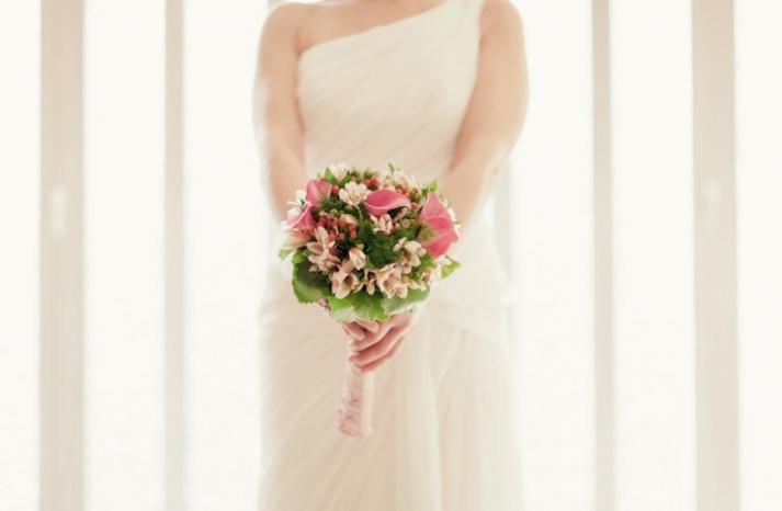 pink green bridal bouquet one shoulder wedding dress