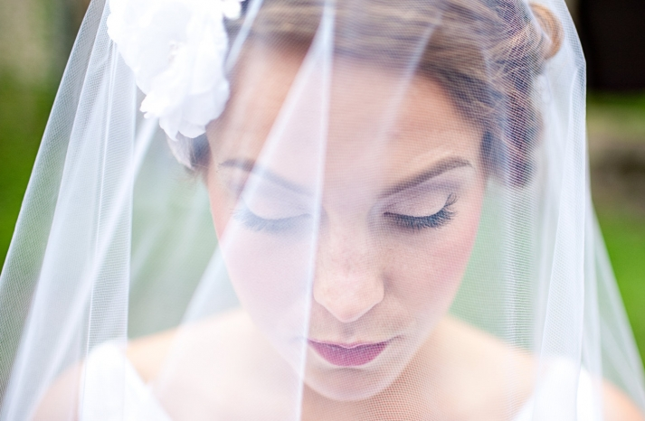 sheer bridal veil with white rosettes