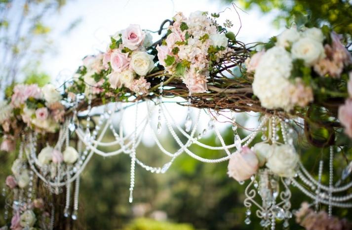 romantic wedding ceremony arbor bamboo roses