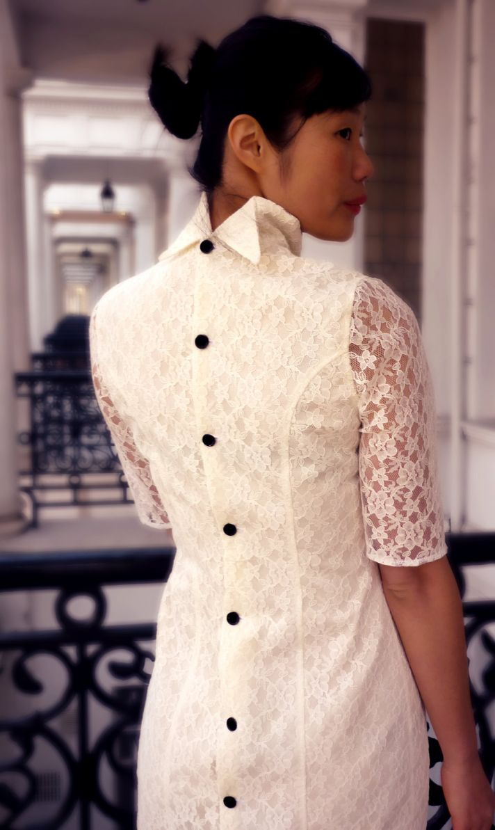 lovely lace LWDs for the brides wedding reception look turtleneck with sleeves black covered buttons
