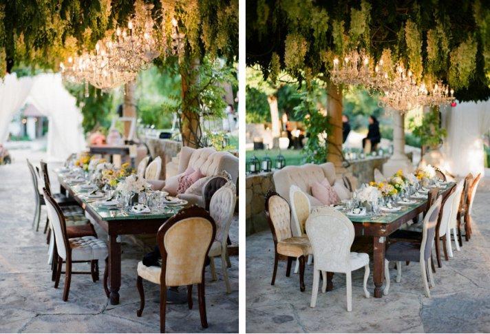 pretty wedding chairs outdoor reception beneath chandeliers