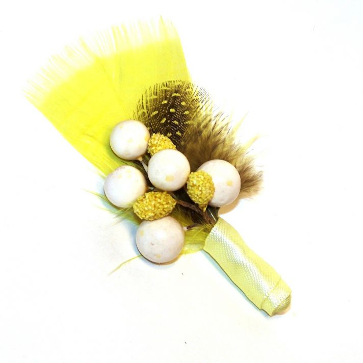 banana bread wedding color inspiration feather boutonniere