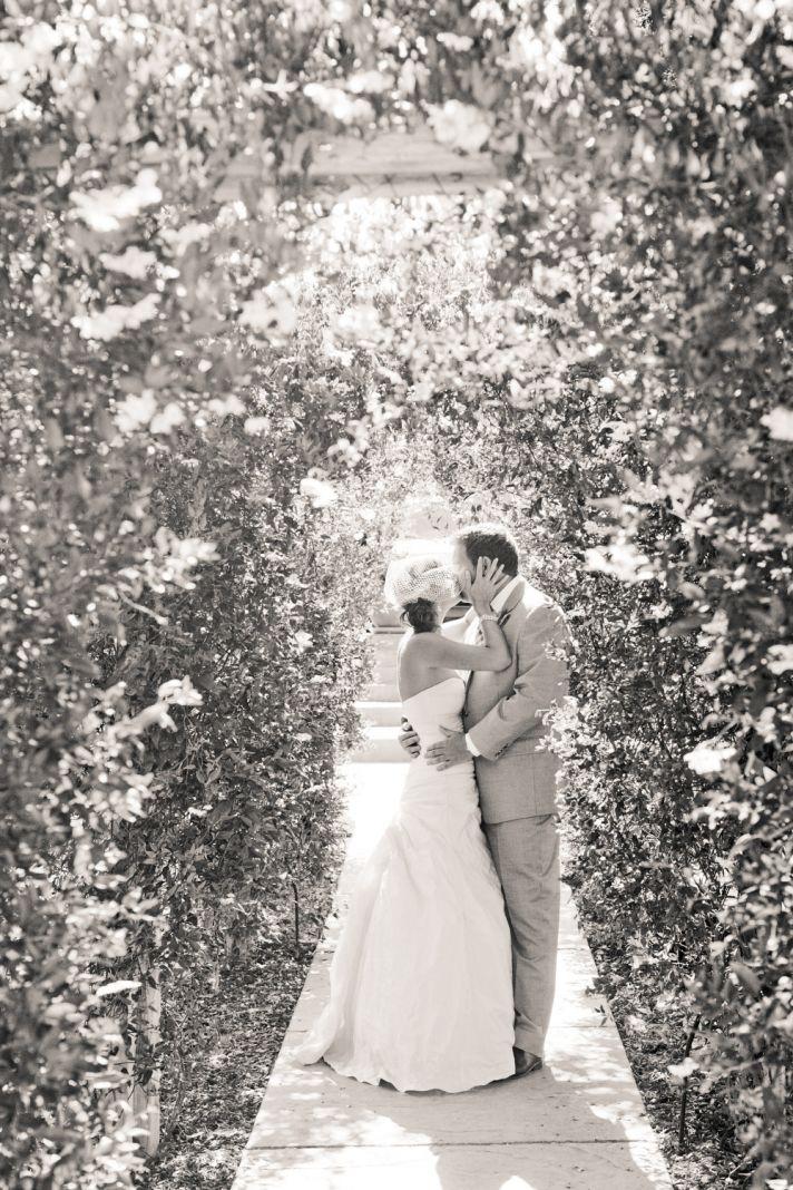 romantic black white wedding photo bride and groom kiss