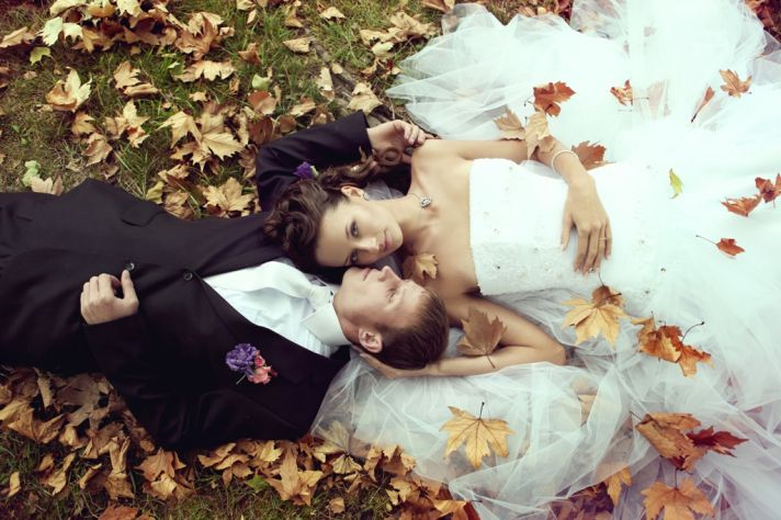 hot wedding planning topics bride groom in bed of leavea