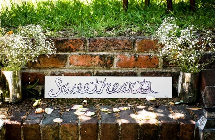 romantic mansion wedding with vintage inspired bride and groom custom sign
