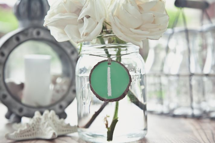 things brides love Mason Jar wedding reception decor centerpieces chalkboard table numbers