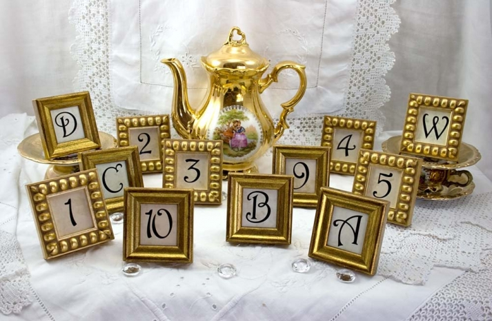 weddings by style Parisian romance wedding decor inspiration gold table numbers