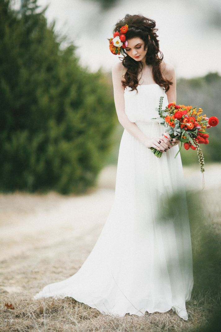 Romantic Fall Bride Poses Outside with Rich Red Bouquet