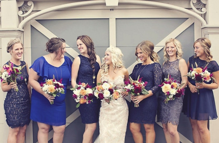 Mix and match bridesmaids in blue