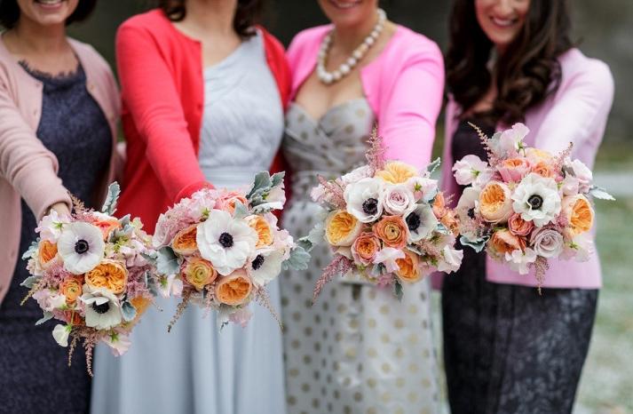 Unique mix and match bridesmaids show off gorgeous bouquets