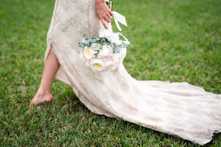 Ivory beaded wedding dress with peony bouquet
