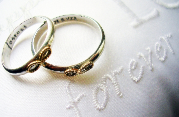 Engraved wedding bands with infinity knot