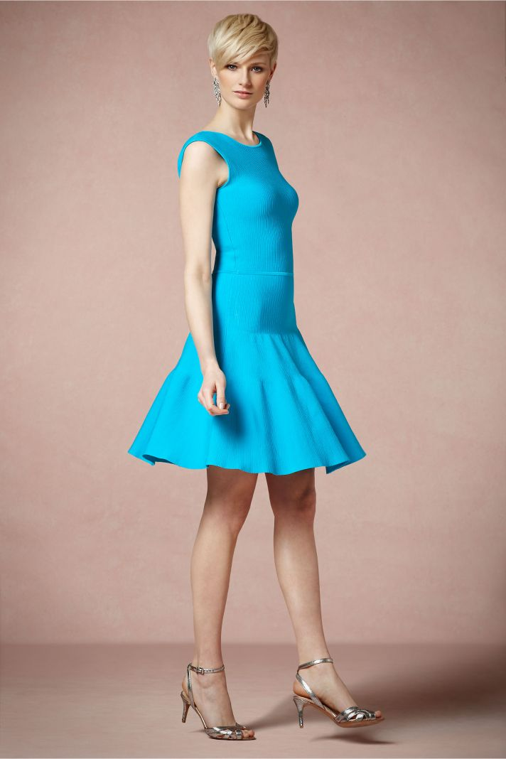 Flouncy turquoise bridesmaid dress with halter neckline