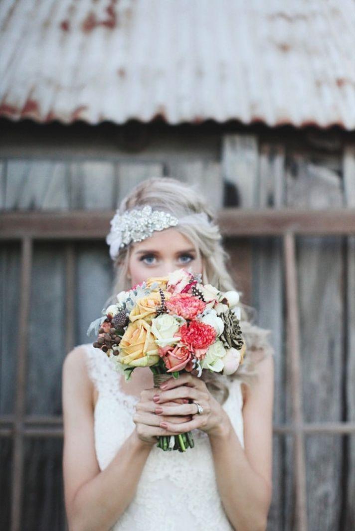Bride wears beaded wedding bandeau holds romantic bouquet