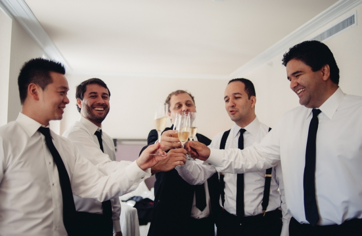 Groom toasts with groomsmen before taking the plunge
