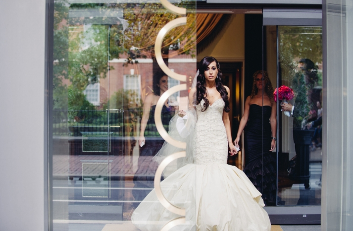 Philly bride wears beaded trumpet wedding dress half up bridal hairstyle