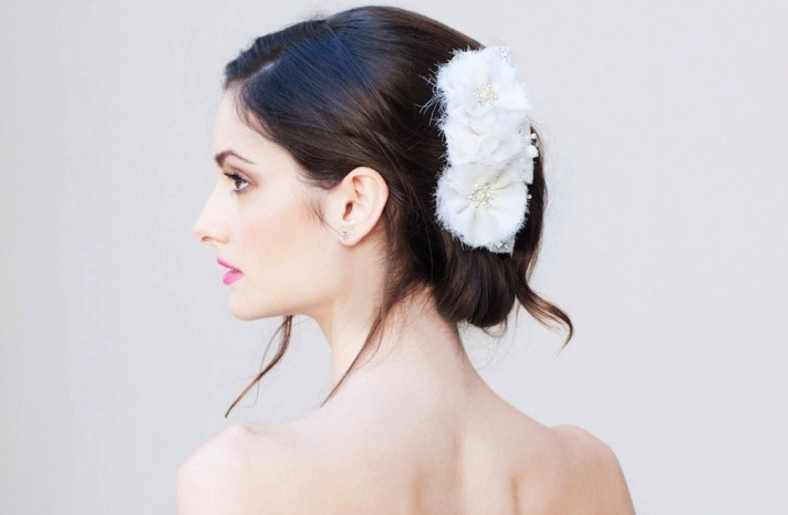 Soft chignon wedding hairstyle with white flowers
