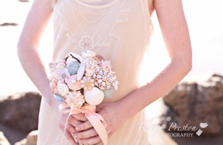 Pastel seashell brooch wedding bouquet