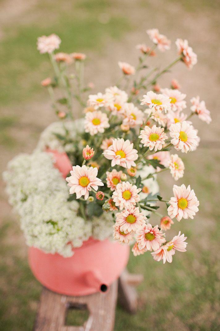 pastel peach and yellow daisy wedding flowers
