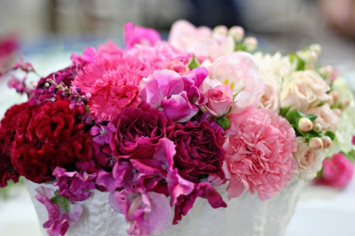 pink ombre wedding centerpiece with red coxcomb