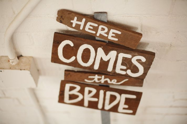 Rustic offbeat wedding ideas Here Comes the Bride Sign
