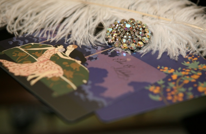 Feather and brooch embellished art deco wedding invites