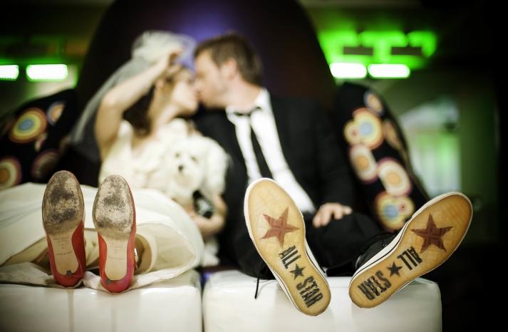 Fun wedding shoe shot bride and groom show their soles