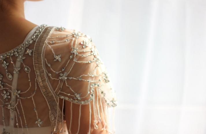 Sheer beaded wedding dress top with flutter sleeves