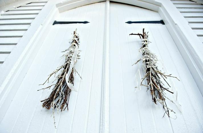 Twiggy door decor for chapel wedding ceremony