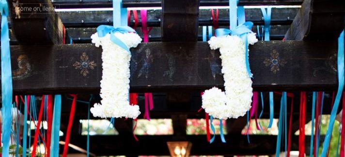 White floral wedding monogram with blue ribbon