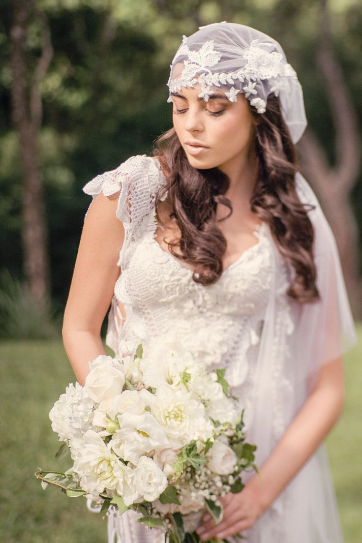 Bohemian bride wears lace juliet cap with crochet gown