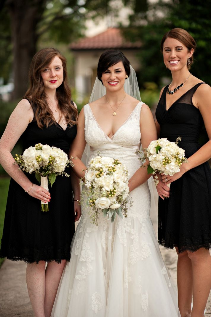 Vintage bride poses with classic bridesmaids in black