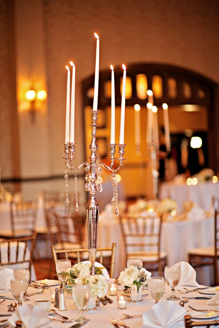 Vintage candelabras atop classic reception tables