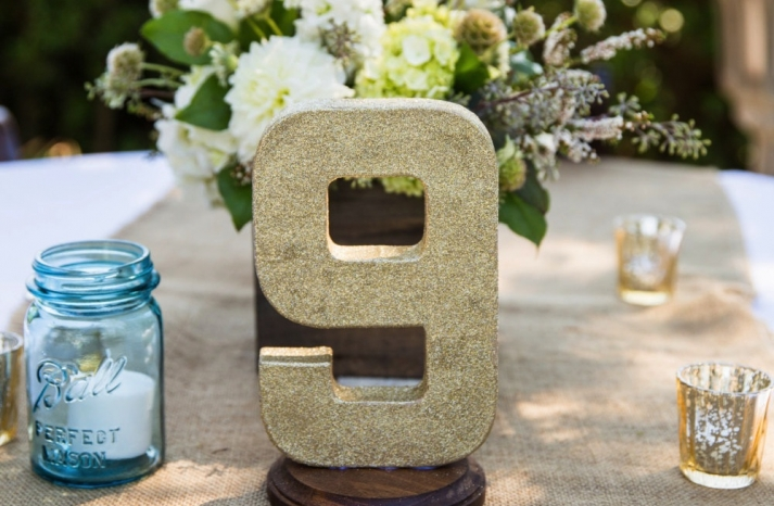Gold glitter wedding table number for outdoor reception