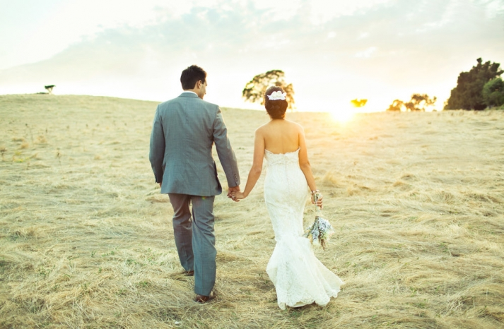 Amazing wedding photography by Shannen Natasha bride and groom walk off into the sunset