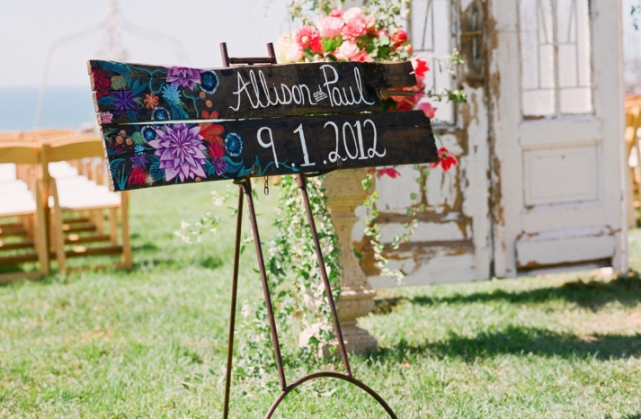 wood wedding sign painted with bright florals
