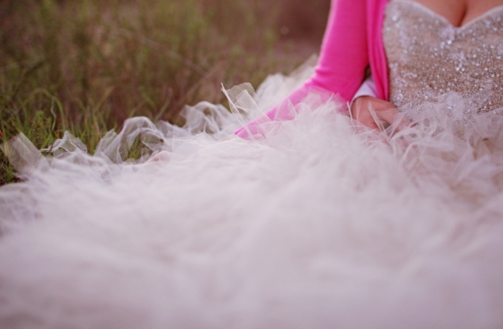 bride wears beaded ball gown with pink sweater