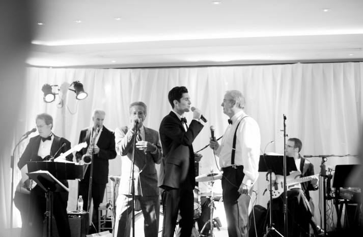 groom joins the band at his wedding reception