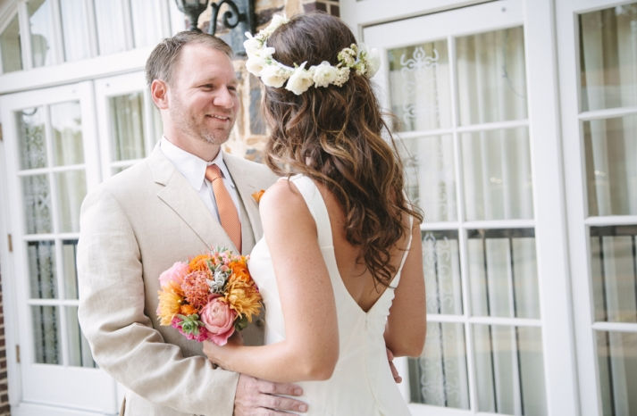 whimsical summer wedding with a bride wearing loose waves and a floral crown
