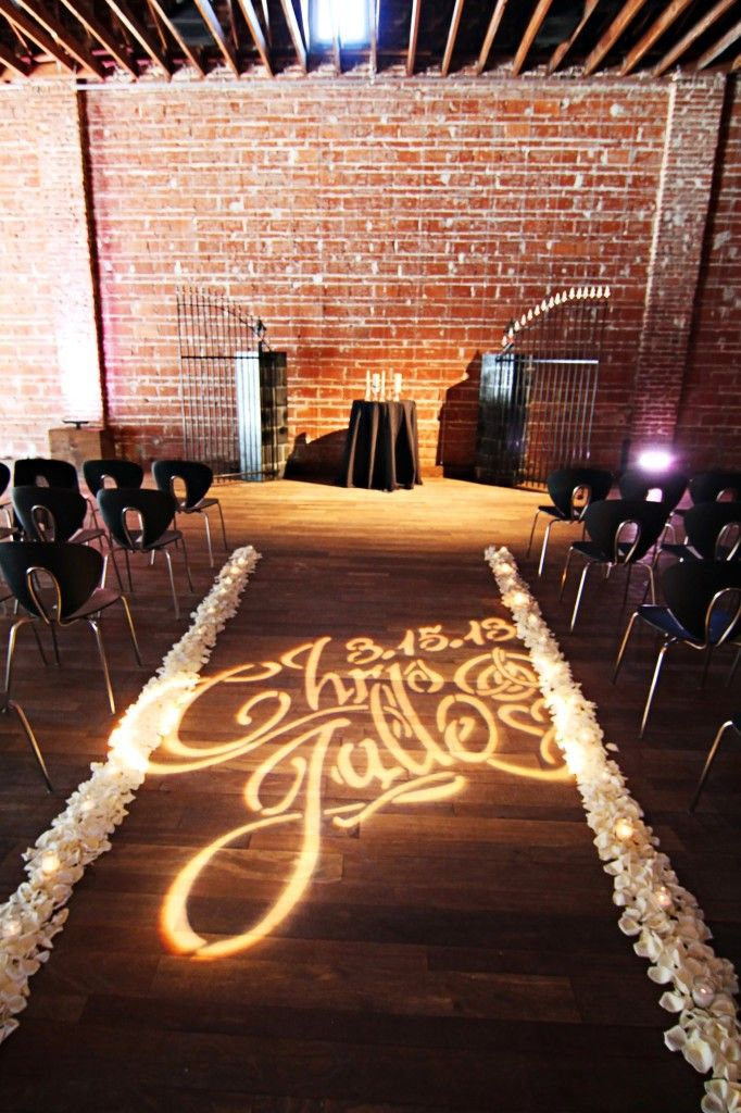 Old Hollywood Glamour Wedding Decor custom wedding monogram lighting on ceremony aisle