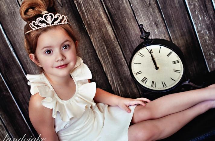 adorable cream flower girl dress with ruffled neckline