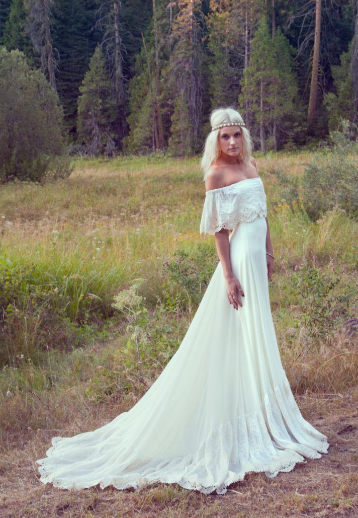 cream bohemian wedding gown with crochet trimmed neckline