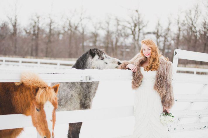 vintage winter bride wears chic fur jacket