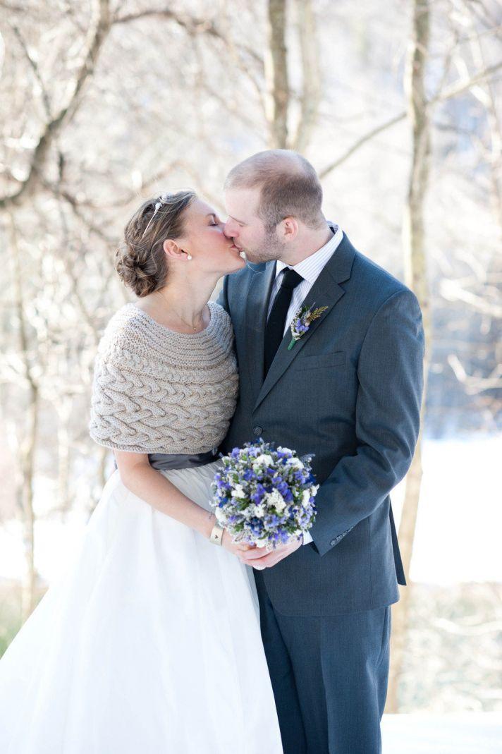 winter bride wears cableknit wedding sweater