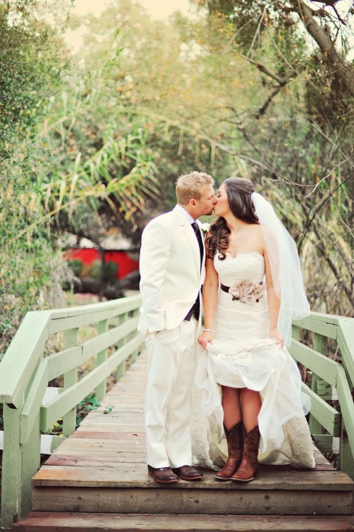 Adorable rustic wedding couple on a bridge