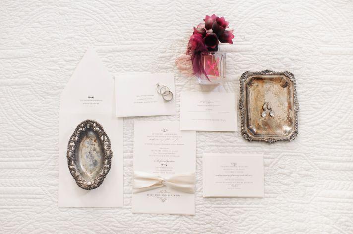 White classic wedding invitations and bridal jewelry