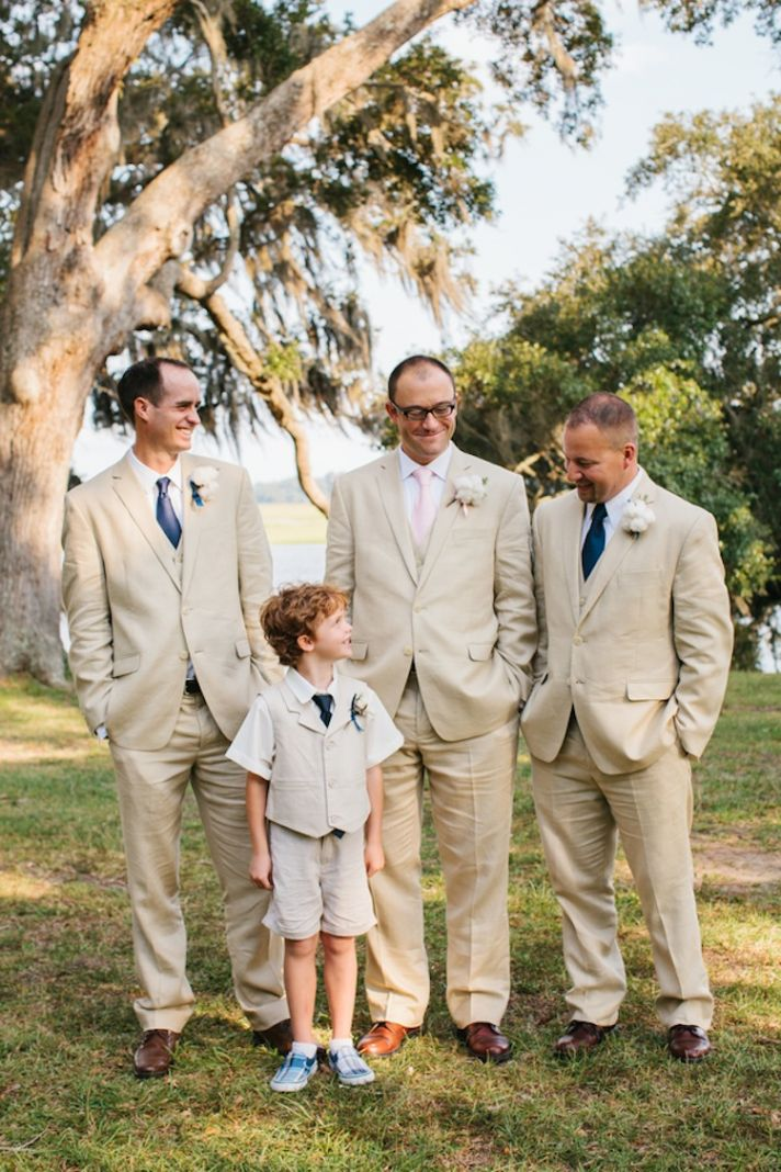 Groom and groomsmen in tan suits with ring bearer