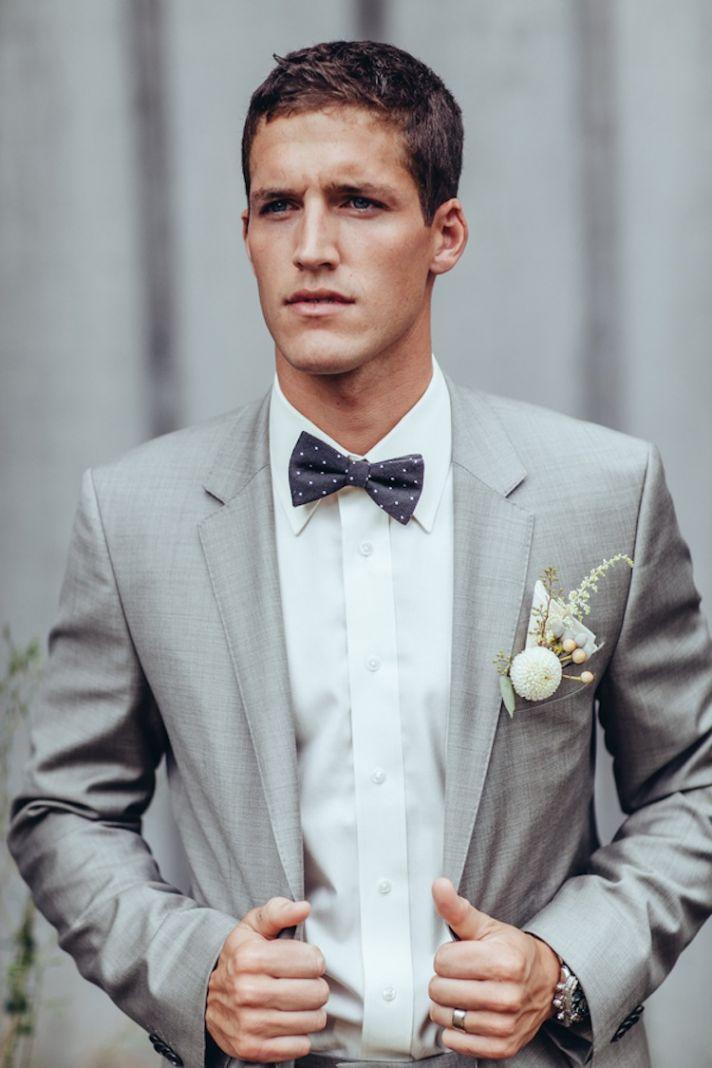 Dapper real groom in suit
