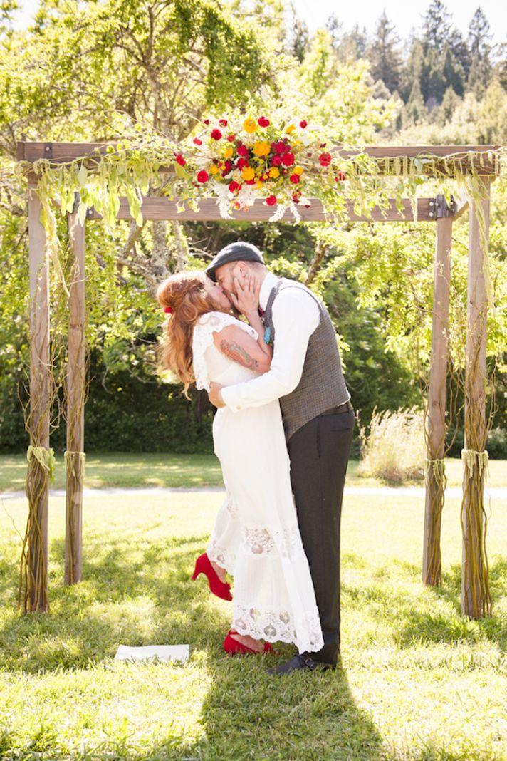 Ceremony kiss under summer skies