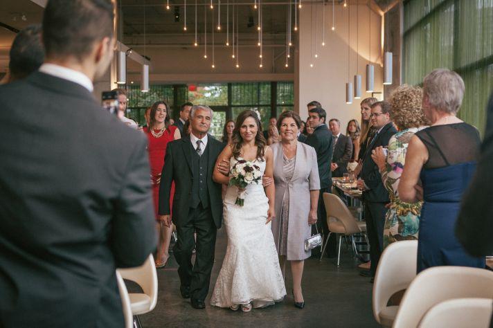 Bride with parents at an indoor ceremony